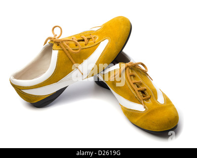 Pair of yellow flat shoes isolated on white background - Stock Photo