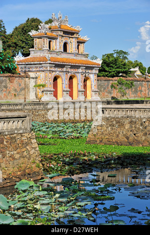 One of the gates of the Imperial City / Citadel of Hue, Vietnam - looking from inside the city across the ornate - Stock Photo