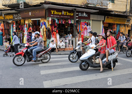 Hanoi, Vietnam - street scene at a road junction - Stock Photo