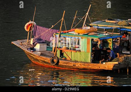 Ha long Bay, Vietnam at sunset / dusk - fisherman - Stock Photo