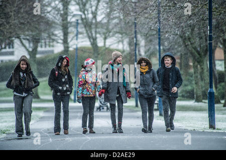 Aberystwyth, Wales, UK. 18th January 2013.  A group of 6th form pupils at Penweddig School walking to school as - Stock Photo