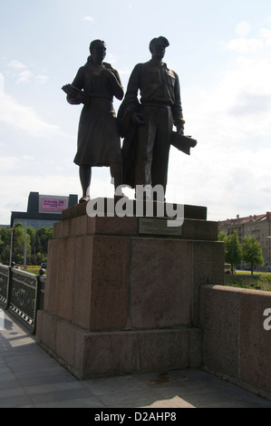 One of the four Socialist Realist statues on the Green Bridge over the River Neris in Vilnius,Lithuania, Baltic - Stock Photo