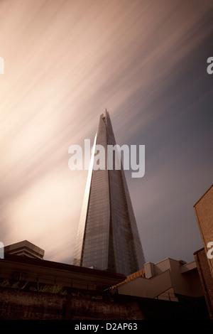 Skyscraper overlooking city streets - Stock Photo