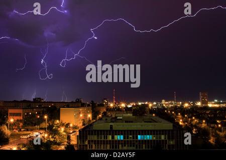 Lightning during thunderstorm over the city of Prague, Czech Republic (long exposure). - Stock Photo