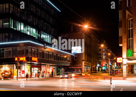 Vivid night scenery showing light traces of cars passing by in long exposure at an intersection on November 8, 2012 - Stock Photo