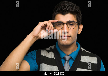 Portrait of a man wearing eyeglasses - Stock Photo
