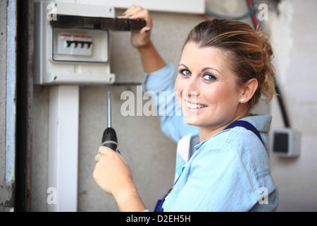 France, young woman with screwdriver tool - Stock Photo