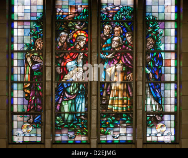 BRUSSELS - JUNE 22: Jesus rescues the sinful woman. Windowpane in National Basilica of the Sacred Heart - Stock Photo