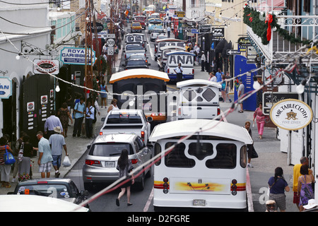 Taxis, Cars and Shops along Main Street / Dronningens Gade, Charlotte Amalie, St. Thomas, US Virgin Islands, Caribbean - Stock Photo