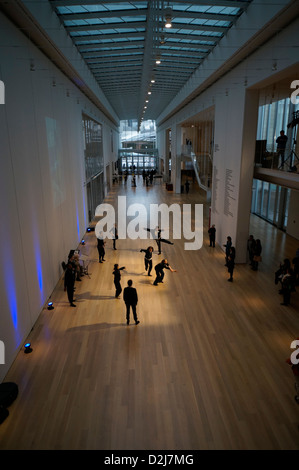 Dancers performing to music. Kenneth and Anne Griffen Court in the Modern Wing of the Art Institute Chicago, Chicago, - Stock Photo