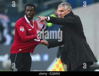 Hannover, Germany. 26th January 2013. Hannover's head coach Mirko Slomka (R) gives instructions to his player Mame - Stock Photo
