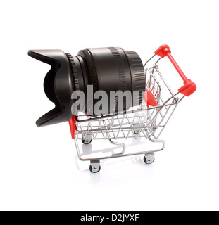 Camera lens with hood in shopping cart isolated on white. Shopping for photography concept - Stock Photo