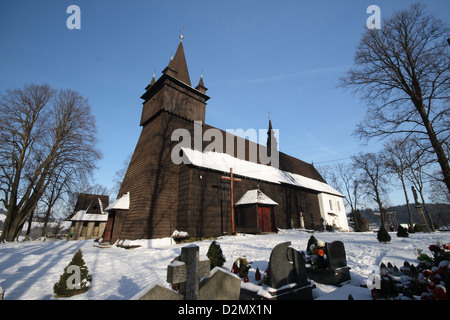 A very old wooden church on a hilltop on a beautiful sunny winter's day. - Stock Photo