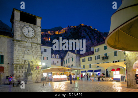 Old Town Clock Tower and Fort at dusk, Old Town, UNESCO World Heritage Site, Kotor, Montenegro, Europe - Stock Photo