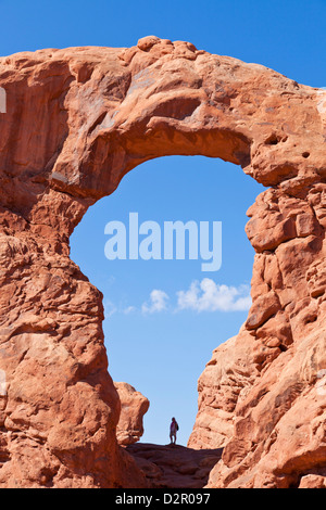 Lone hiker in Turret Arch, Arches National Park, near Moab, Utah, United States of America, North America - Stock Photo