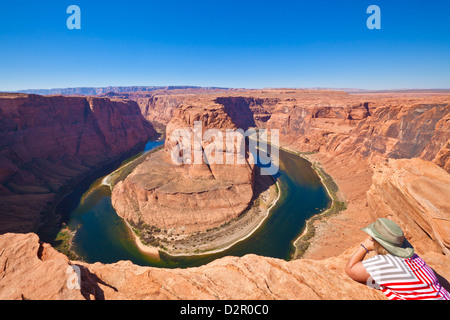 Tourist overlooking Horseshoe Bend on the Colorado River, Page, Arizona, United States of America, North America - Stock Photo