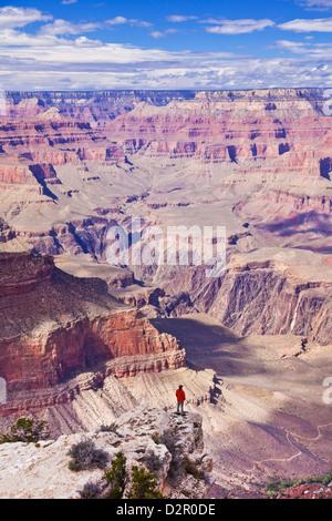 Lone hiker near Yavapai Point Overlook, South Rim, Grand Canyon National Park, Arizona, USA - Stock Photo