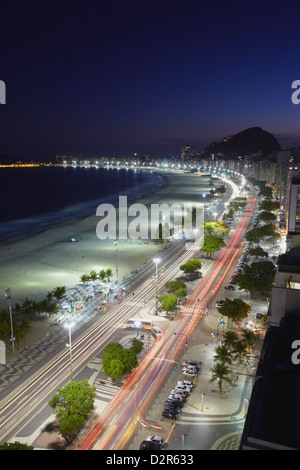 View of Copacabana beach and Avenida Atlantica at dusk, Copacabana, Rio de Janeiro, Brazil, South America - Stock Photo