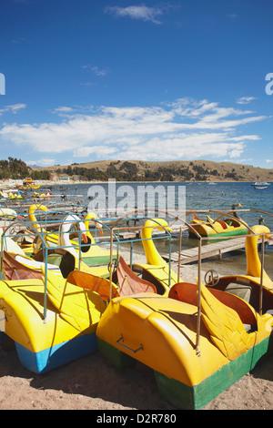 Pedaloes on beach, Copacabana, Lake Titicaca, Bolivia, South America - Stock Photo