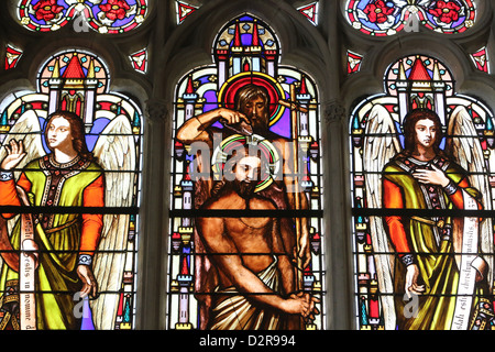 Stained glass window depicting the Baptism of Jesus by John the Baptist, St. Germain l'Auxerrois church, Paris, - Stock Photo