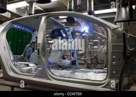 Wolfsburg, Germany, Volkswagen factory, welders under construction - Stock Photo