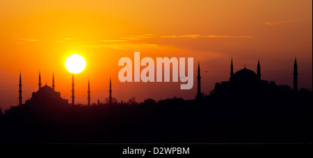 Blue Mosque and Hagia Sophia in Istanbul at sunset - Stock Photo