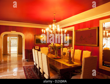 Chandelier over dining table in luxury dining room - Stock Photo