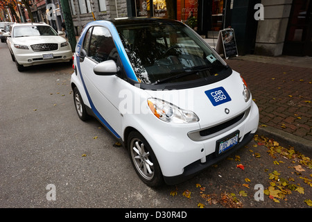 car sharing car2go electric car parked in a parking spot in downtown Vancouver BC Canada - Stock Photo