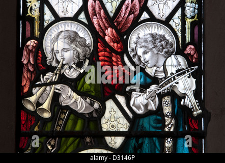 Angel musicians stained glass, St. Barbara`s Church, Ashton-under-Hill, Worcestershire, England, UK - Stock Photo