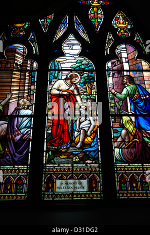 jesus healing the stick stained glass window in holy rosary cathedral Vancouver BC Canada - Stock Photo