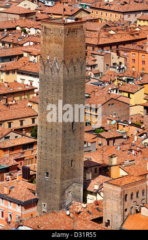 View of leaning tower from Asinelli tower. Towers are symbol of the town of Bologna - Stock Photo