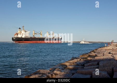 Freighter transporting grain, Corpus Christi ship channel. - Stock Photo