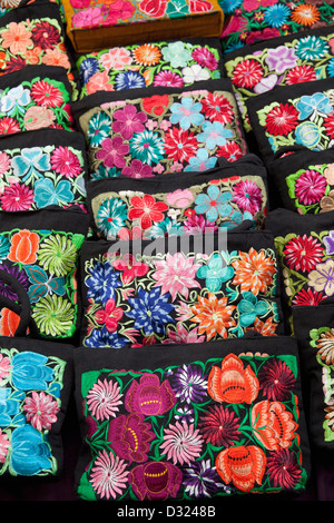 Closeup of hand-embroidered bags for sale at market on Zocalo, Oaxaca, Mexico. - Stock Photo