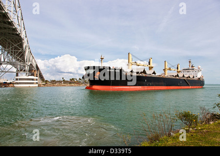 Freighter transporting grain, entering Port Of Corpus Christi, Texas - Stock Photo