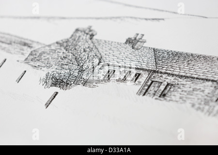 Artist drawing / sketching in studio pen and ink line drawing of old Scottish cottage architecture in Orkney islands. - Stock Photo
