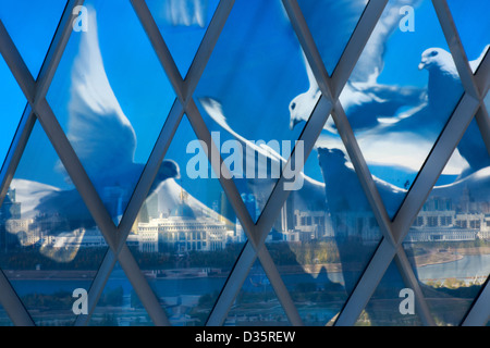 Doves on the glass face of the Palace of Peace and Reconciliation, a pyramid designed by Norman Foster in Astana, - Stock Photo