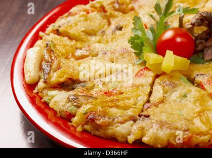 Japanese food close-up Okonomiyaki.(Japanese pizza) - Stock Photo
