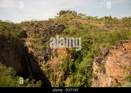 Tolmer Falls cascades over a high sandstone escarpment into a deep pool, Litchfield National Park, Northern Territory, - Stock Photo