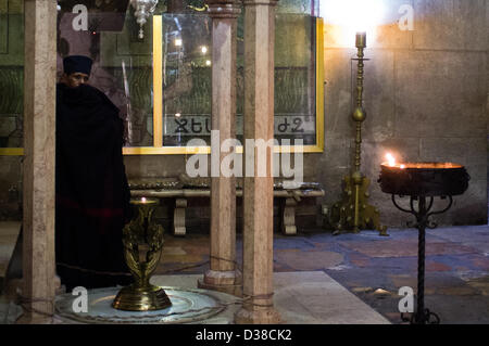 Jerusalem, Israel. 13th February 2013. An Ethiopian priest at the Church of The Holy Sepulchre. Jerusalem, Israel. - Stock Photo