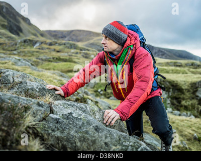 Man hiking in rocky landscape - Stock Photo