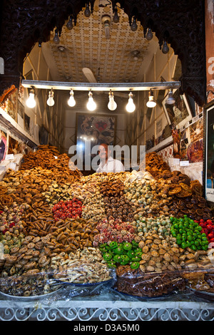 Man selling produce in Souk, Marrakech, Morocco - Stock Photo