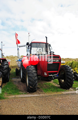 A tractor, boat and buoys used by inshore fishermen at Caister-on-Sea, Norfolk, England, United Kingdom. - Stock Photo