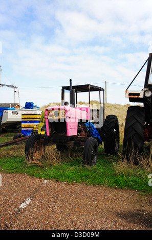 A pink tractor used by inshore fishermen at Caister-on-Sea, Norfolk, England, United Kingdom. - Stock Photo