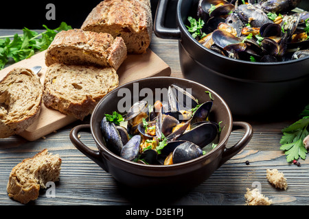 Fresh vegetables and mussels prepared in the home - Stock Photo
