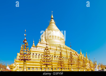 11th Century Shwezigon Pagoda in Bagan in Myanmar (formerly Burma). This is a stitch of several images. - Stock Photo