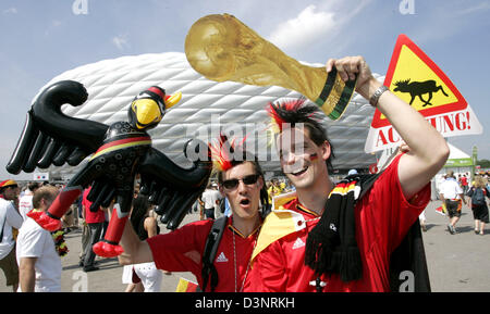 German supporters cheer for their team prior to the 2006 FIFA World Cup round of 16 match Germany vs Sweden in Munich, - Stock Photo