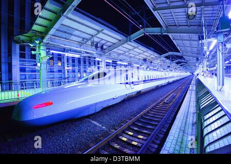 A Nozomi bullet train in Kyoto Station, Kyoto, Japan. - Stock Photo