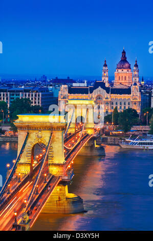 The Chain Bridge over the river Danube illuminated at sunset with traffic light trails Budapest, Hungary, Europe, - Stock Photo