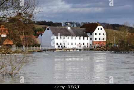 Bucks - Hambleden Mill End on the Thames - the mill and weir - spotlight of winter sun - the river in flood - Stock Photo