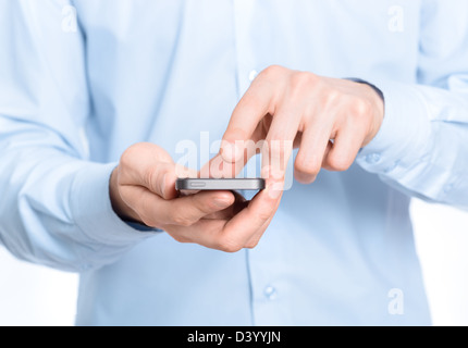 Businessman holding and touching screen on mobile phone. Close-up photo. - Stock Photo